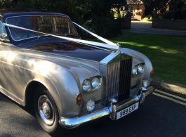 Burgundy and Silver Rolls Royce wedding car in Egham